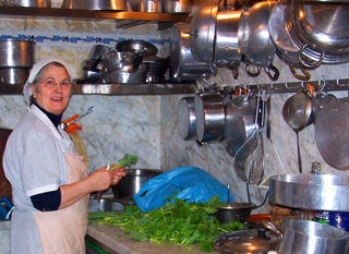 Teresa in the kitchen at Trattoria Settimio Pellegrino