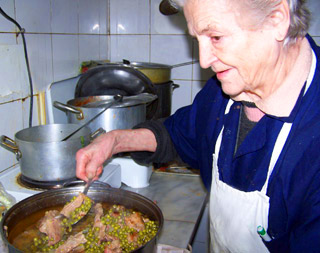 Ada prepares to serve boiled veal with spinach and peas