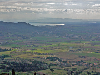 Scenic landscape from Cortona with Lago Trasimeno in the distance.