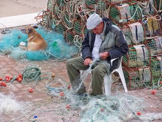 Fisherman mending his nets, Cascais, Portugal